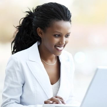 Black business woman with laptop crop
