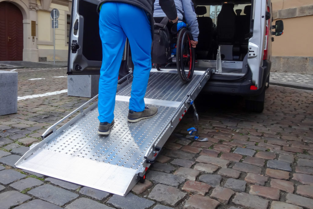 opportunity to help: loading wheelchair into van