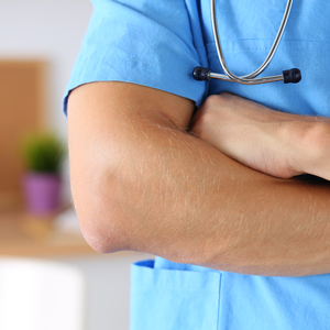 bigstock-Physician-Wearing-Blue-Uniform-1002524932